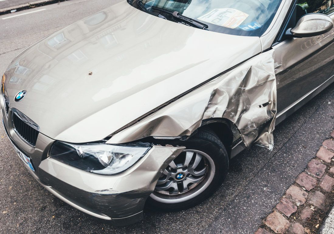 Strasbourg, France - Mar 12, 2019: Above view of luxury BMW german car parked on city street with damaged front by accident on the road